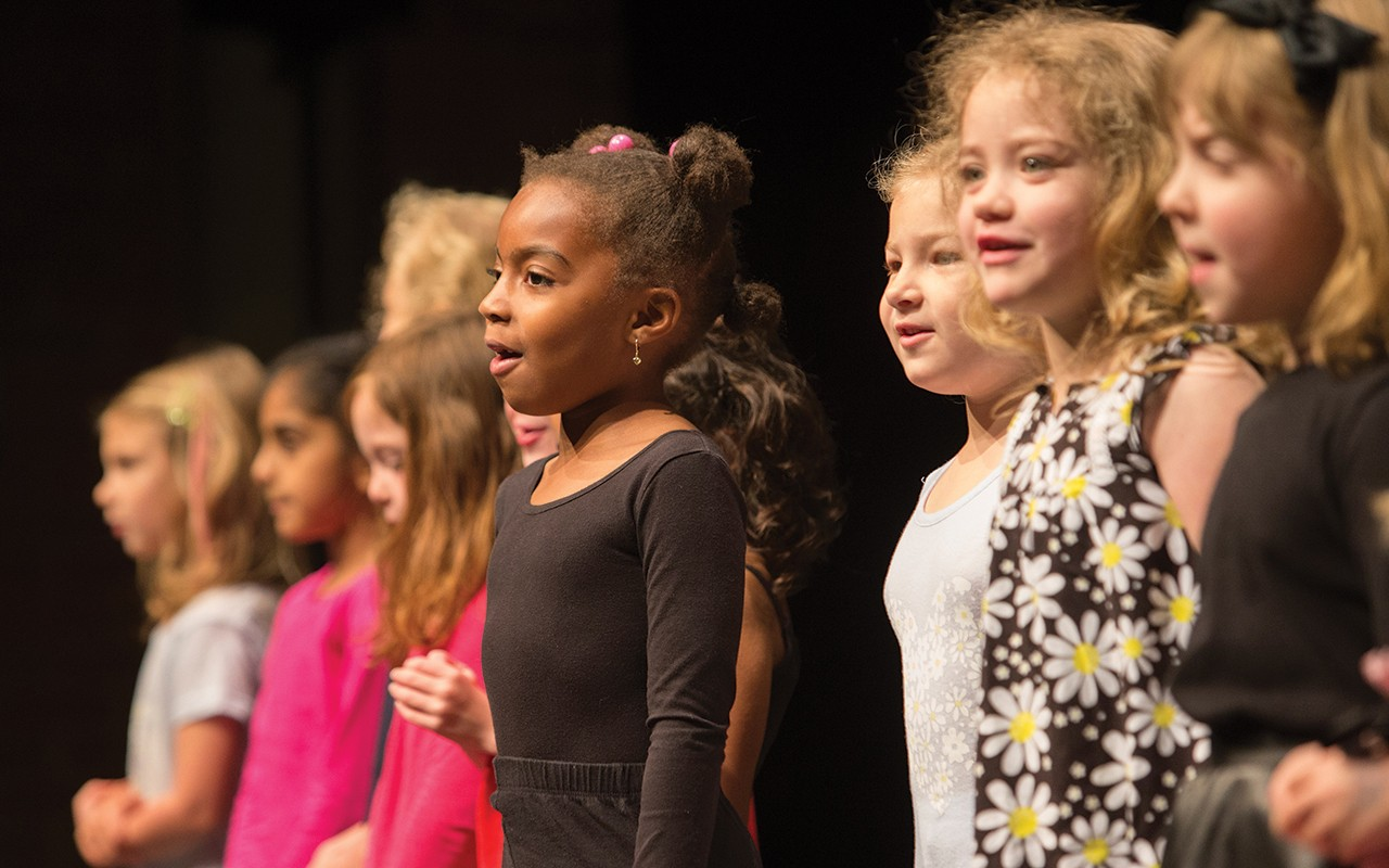Primary school-aged students sing on stage during the CCM Prep's Year End Festival