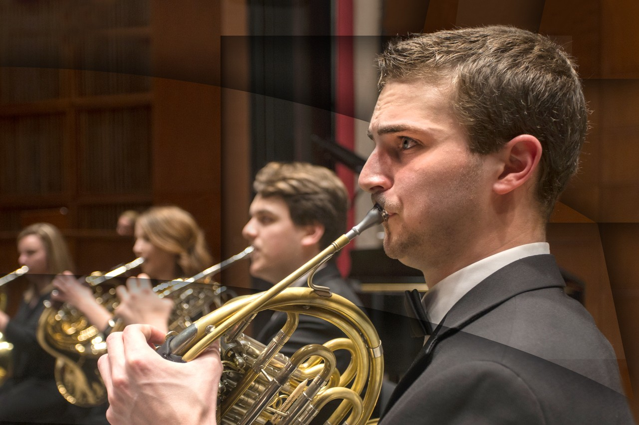 Two saxophone students perform on stage with the CCM Jazz Orchestra during the 2020 Moveable Feast benefit
